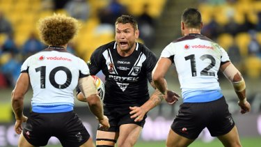 Moving forward?: Jared Waerea-Hargreaves charges into Eloni Vunakece and Brayden Wiliame.