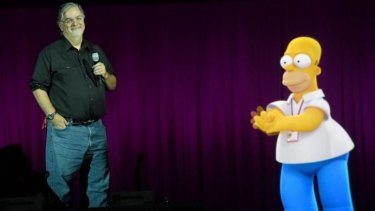 Homer help ... Matt Groening takes questions on plans for a <i>Simpsons</i>/<i>Family Guy</i> crossover episode with a little assistance from his most famous creation.
