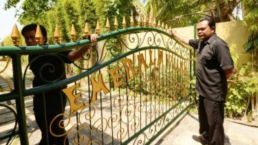 Murder scene: Security guards at the gates of Emerald Villas, near where body of Bob Ellis was found.