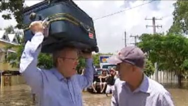 Kevin Rudd helping out flood victims in Norman Park earlier this week.