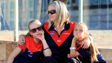 Demons fans gather at Federation Square ahead of Jim Styne's funeral at St Paul's Cathedral.