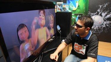 First buyer Vishal Sabhlok, 29, of Chatswood views his new 3D TV.