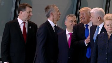 Getting ahead: US President Donald Trump pushes Montenegro Prime Minister Dusko Markovic, second right, at the NATO meeting in Brussels in May.