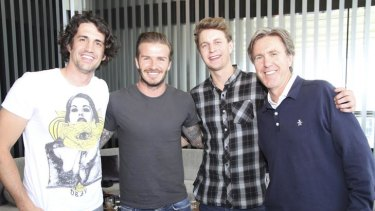 Fox FM's Andy Lee (left), Glenn Robbins (right) and ''Cacklin''' Jack Post with David Beckham.