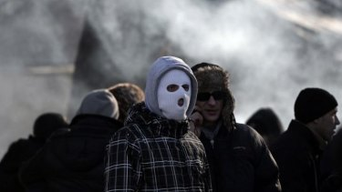 Pro-government supporters stand at a camp next to the parliament in Kiev.