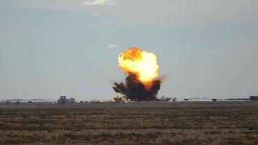 A bomb explodes at the Woomera rocket range.