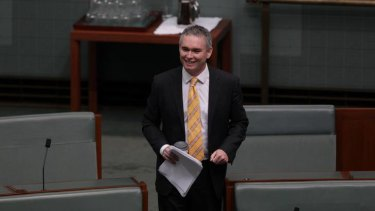 Gotcha ... independent MP Craig Thomson votes with the opposition during a division in in Parliament this morning.