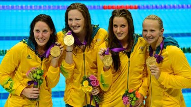 The Aussie four of Alicia Coutts, Cate Campbell,  Brittany Elmslie and Melanie Schlanger show off their medals