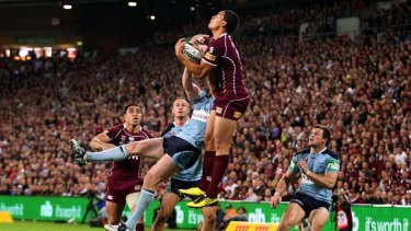Israel Folau proves his worth to his new code with an almighty leap for the ball.