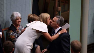 Treasurer Joe Hockey is embraced by his wife Melissa after he delivered his first budget. Photo: Andrew Meares
