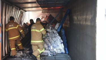 Unloading the Red Bull off the truck that rolled over and hit the Flinders Street Bridge causing traffic chaos.