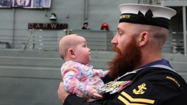 Family support: Leading Seaman Brent Anschaw meets his new daughter, Olivia, for the first time after returning from the Gulf.