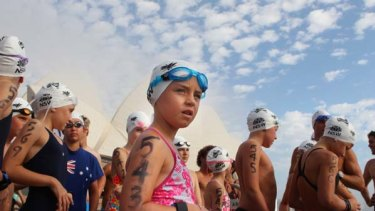 Fun for some but reminders of heartache for others ... youngsters took part in the Great Aussie ocean swim at Farm Cove in Sydney.