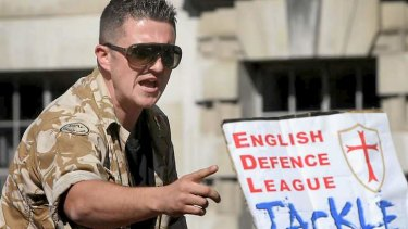English Defence League leader Tommy Robinson speaks to supporters during a rally outside Downing Street this week.