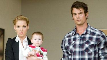 Instant family ... Katherine Heigl, Josh Duhamel and one of the Clagett triplets.