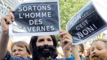 Protesters in Paris call on France to abandon its ''caveman attitudes'' towards women.