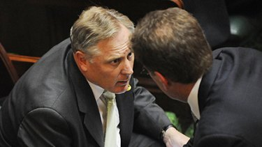 Andrew McIntosh confers with his leader, Ted Baillieu, yesterday.