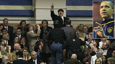 A protester is escorted out as he heckles President Barack Obama during the 2009 graduation ceremony at the University of Notre Dame.