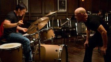 Beat crazy: Andrew (Miles Teller) drums  for his life for teacher Fletcher (J. K. Simmons) in <i>Whiplash</i>.