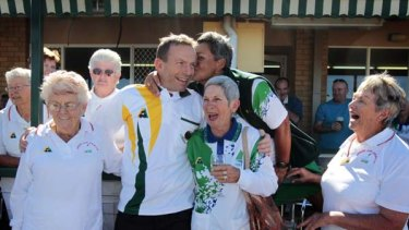 On a roll . . . Tony Abbott charms the ladies at the Kallangur Bowling Club in Queensland yesterday.