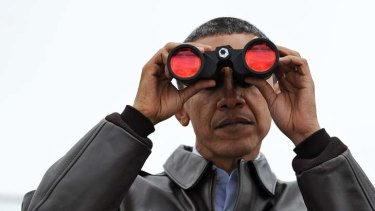 Staring into the void ... Barack Obama peers across the demilitarised zone into North Korea after arriving in Seoul for a nuclear security summit.