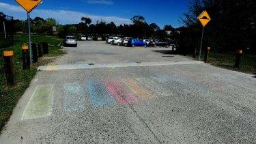 A rainbow coloured crossing at Trinity Christian school, Wanniassa.