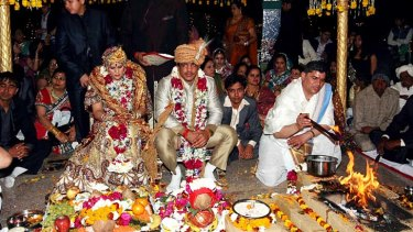 Wrestler Sushil Kumar with his bride Savi during their wedding in Delhi. The government is consider limiting the number of guests at social events, as well as the dishes that can be served.