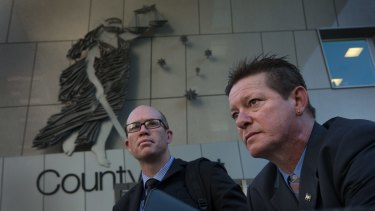 Franc Titan (right) and detective senior Constable Craig Jarvis, who helped Mr Titan bring David Whitcroft to justice