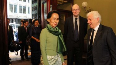 Humble: Aung San Suu Kyi with Frank Lowy and Dr Michael Fullilove at the Lowy Institute. on Thursday.