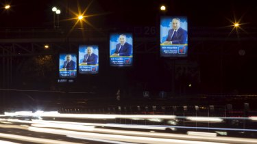 Traffic flows past election posters of Kazakhstan's President Nursultan Nazarbayev on Tuesday.