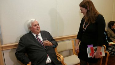 Palmer United Party leader Clive Palmer speaks with Greens Senator Sarah Hanson-Young. Mr Palmer's senators are set to approve the Abbott Government's bills to repeal to carbon tax.