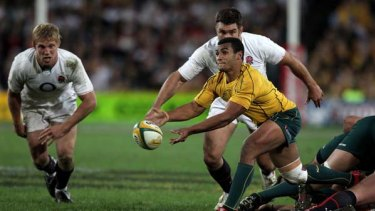 Will Genia passes the ball during the Cook Cup Test Match at ANZ Stadium on June 19, 2010.