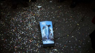 """A small coffin containing a mock sardine at """"The Burial of the Sardine""""  procession which marks the end of Madrid's carnival this week."""