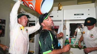This calls for a refreshment: Brad Haddin tips a bucket of energy drink over Lehmann.