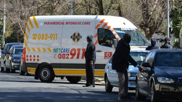 Homecoming: An ambulance carrying Nelson Mandela arrives at his house in Johannesburg on Sunday.