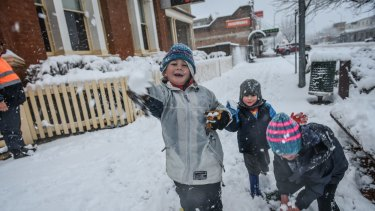 Fun in the snow as local children stay home from school and play in the Biggest snow fall in around 40 yrs as locals wake to a winter wounderland in Oberon NSW this morning .