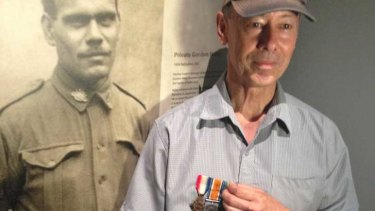 Michael Laing with a photo of his grandfather Gordon Naley and his war medals.