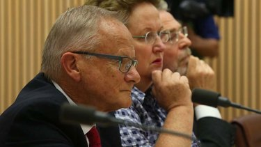 Conflict of interest: Tony Shepherd appearing with fellow commissioners before a Senate Committee in Canberra.