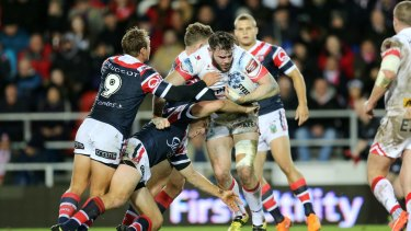 A handful: England forward Alex Walmsley playing for St Helens against the Sydney Roosters in the World Club Challenge last year.