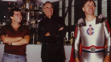 Philippe Mora, Christopher Lee and Alan Arkin on the set of <i>The Return of Captain Invincible</i>.