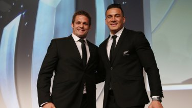 Richie McCaw presents Sonny Bill Williams with his replacement medal, after he gave his original medal to a young fan.