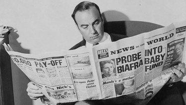 Rupert Murdoch reading <i>News of The World</i>.