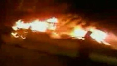 """A still image is seen taken from video footage posted under the title """"Tripoli protesters set ablaze police station at Souq Al Jum'uah"""". A Reuters reporter confirmed that police station was on fire."""