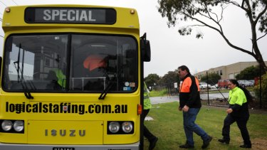 1st Fleet workers board a bus yesterday.