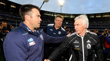Geelong coach Chris Scott shakes hands with his counterpart, Collingwood's Mick Malthouse.