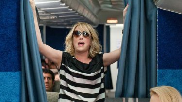 Fasten your seatbelts  ... Kristen Wiig, who co-wrote Bridesmaids with Annie Mumolo, stars as Annie, who morphs from bride's best friend to delinquent maid of honour.