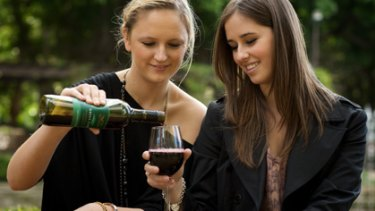 Brooke Bickmore (left) and Lauren Dragosetti with a plastic bottle of wine.
