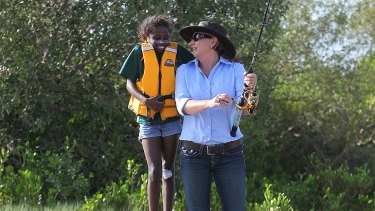 Premier Anna Bligh fishing with Shakeria Tarpencha during her visit to Pormpuraaw.