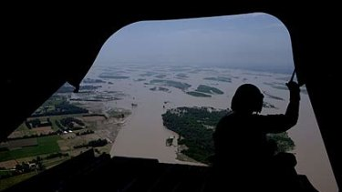 A US helicopter takes supplies to flood victims in Kalam, Pakistan.