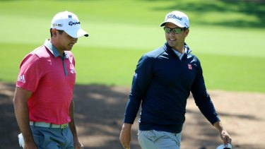 Warming up for the big event: Jason Day and Adam Scott.